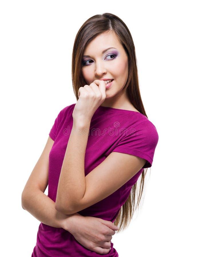 Mooie jonge vrouw met een sluwe blik stock fotografie