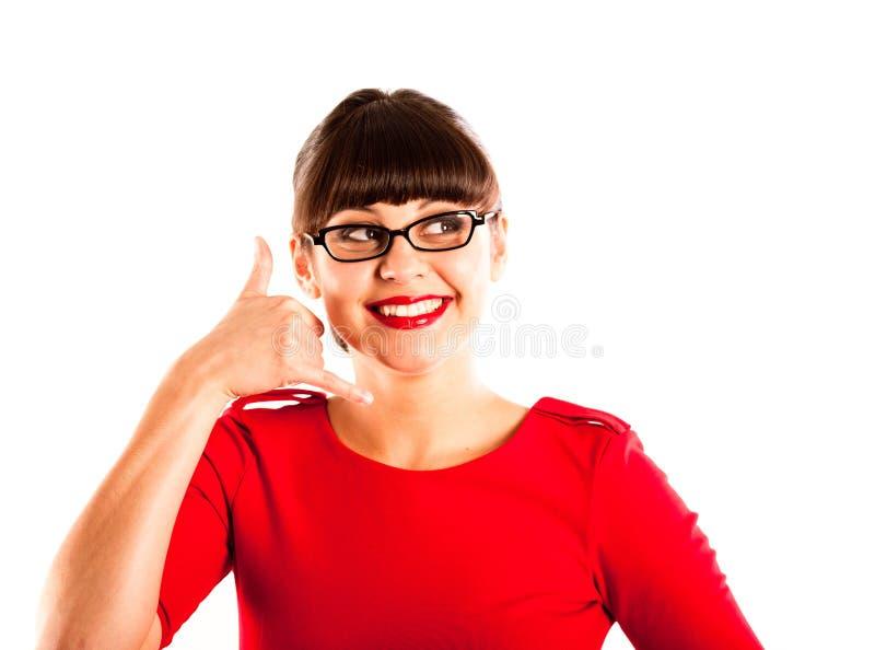 Mooie jonge vrouw in rode kleding die glazen draagt stock afbeeldingen