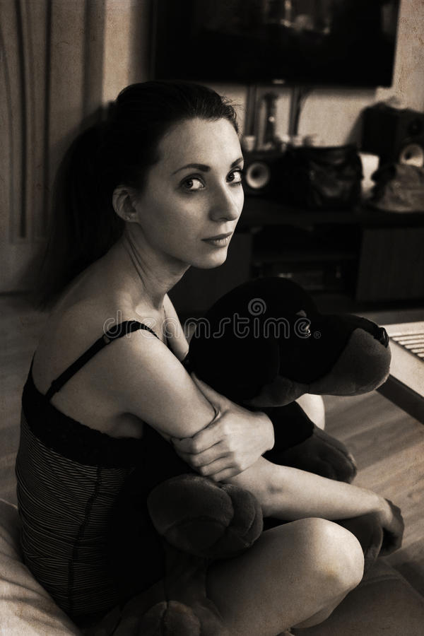 Mooie jonge vrouw, stuk speelgoed royalty-vrije stock afbeelding
