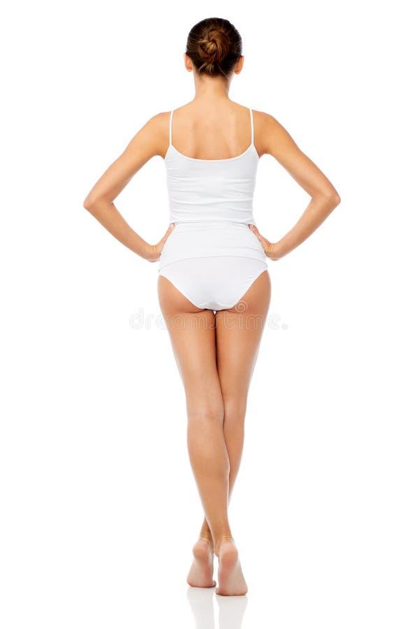 Mooie jonge vrouw in wit ondergoed royalty-vrije stock foto