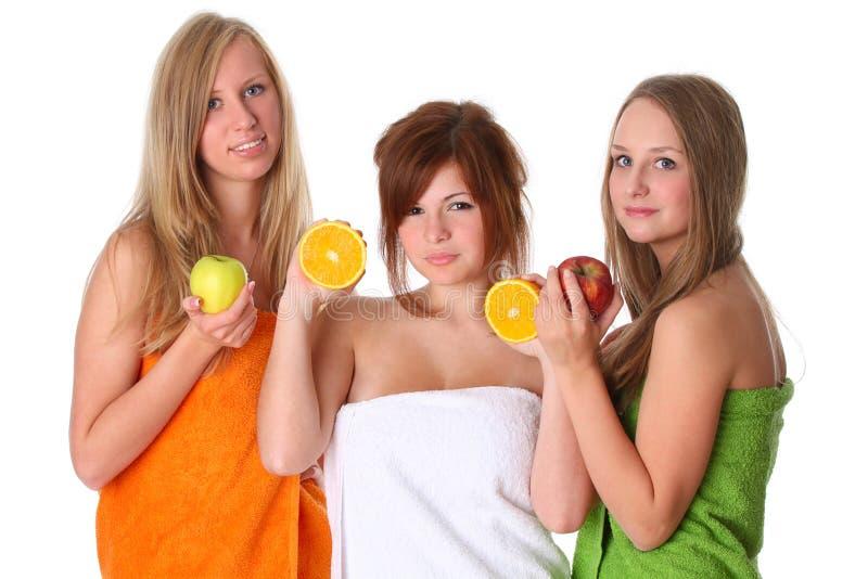 Mooie jonge vrouwen met fruit stock foto
