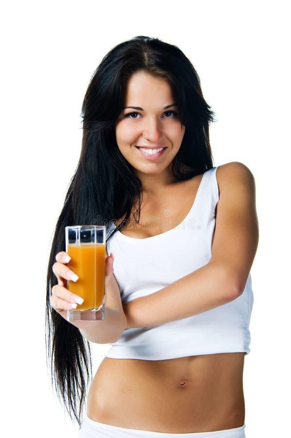 Mooie jonge vrouwen met het glas sap stock afbeelding