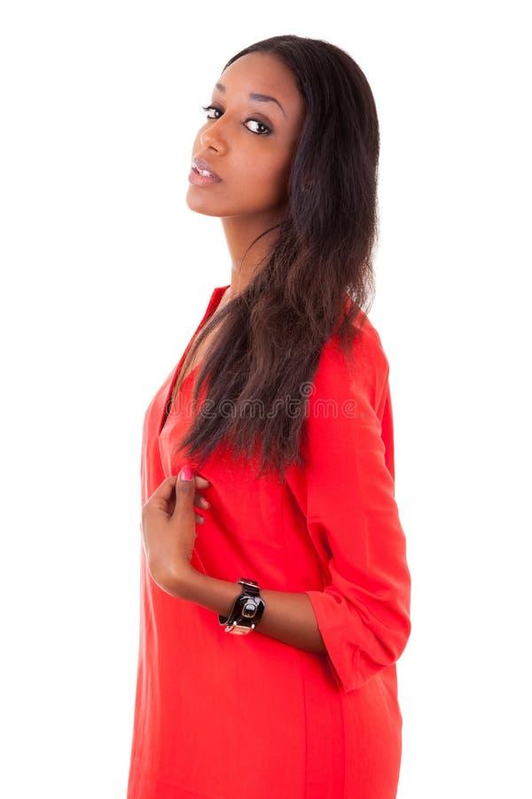 Mooie jonge zwarte in rode kleding stock afbeelding