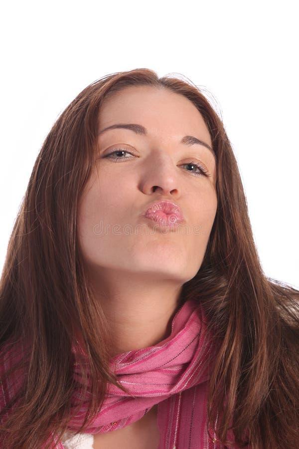 Mooie jongelui een vrouw die kus verzendt stock afbeelding