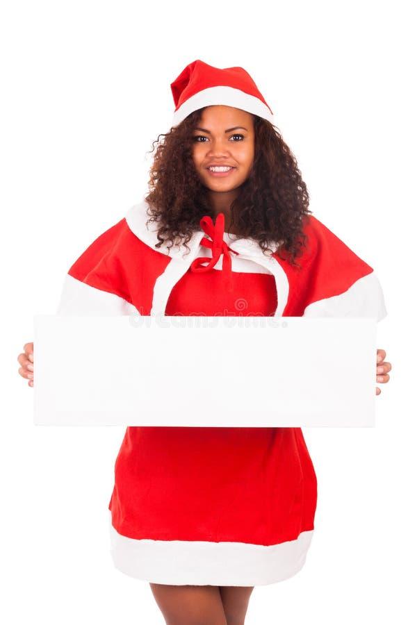 Mooie Kerstmisvrouw in santahoed met lege witte raad royalty-vrije stock afbeeldingen