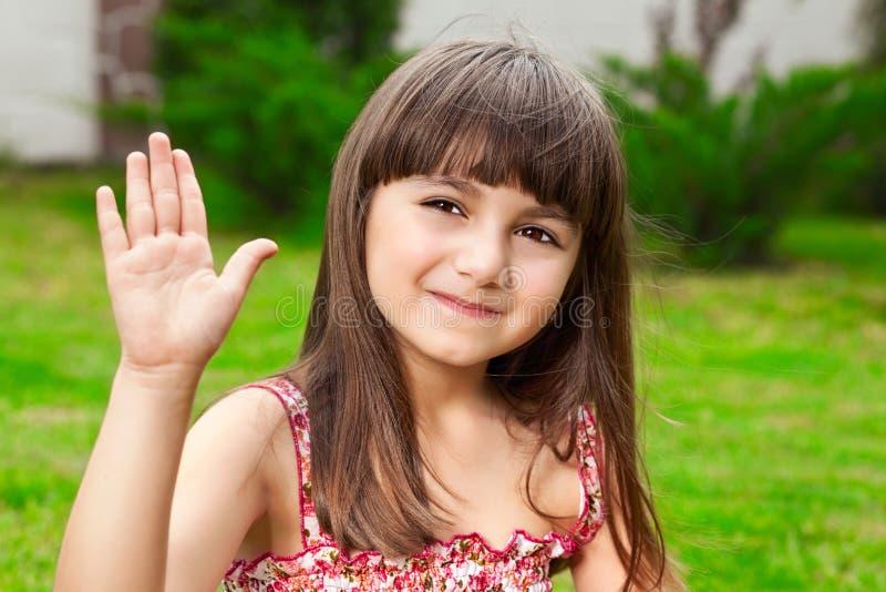 Mooie meisjegolven haar hand stock afbeelding