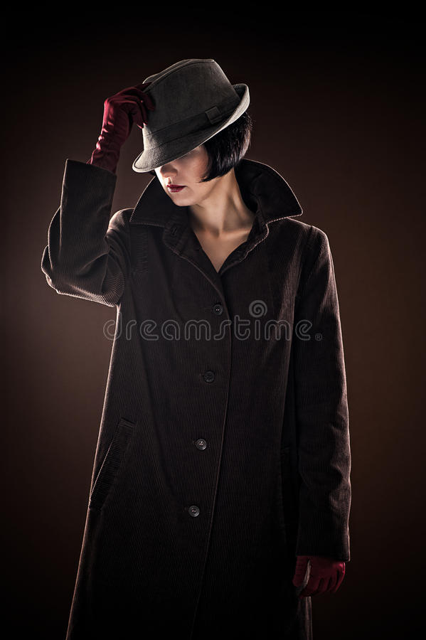 Mooie modieuze vrouwendetective stock fotografie