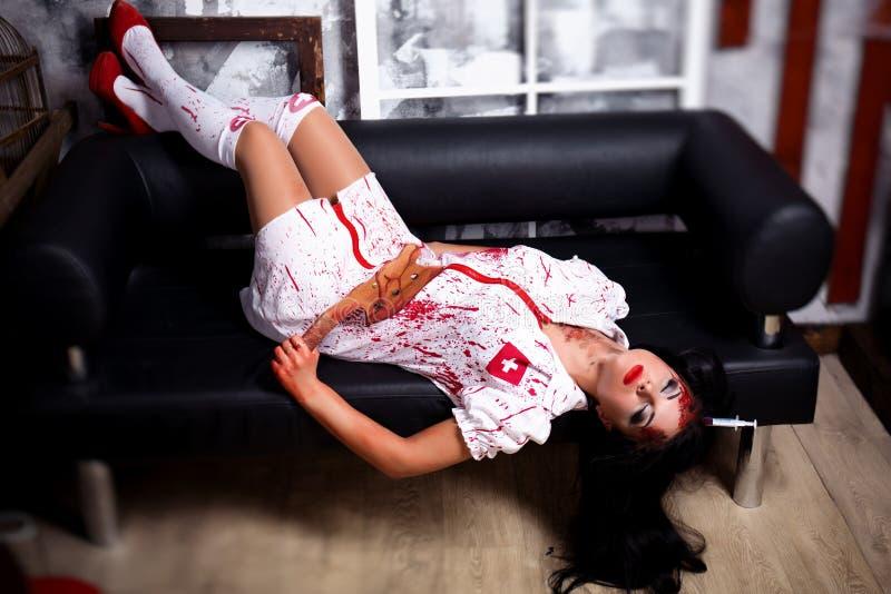 Mooie moordenaarsverpleegster stock fotografie