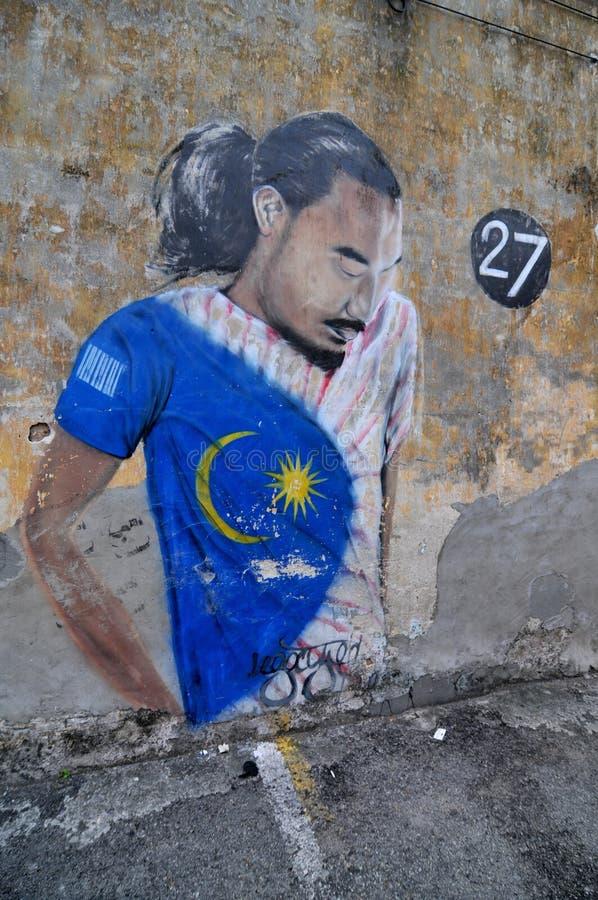 Mooie muurschildering van de 'Mens met een vlag 'die in Georgetown, Penang wordt gevestigd stock afbeelding