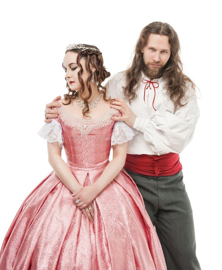 Mooie paarvrouw en man in middeleeuwse kleren stock afbeelding