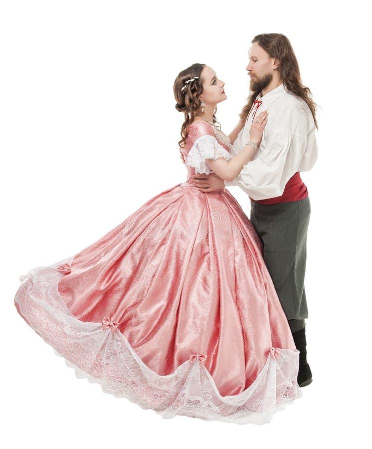 Mooie paarvrouw en man in middeleeuwse kleren stock afbeeldingen