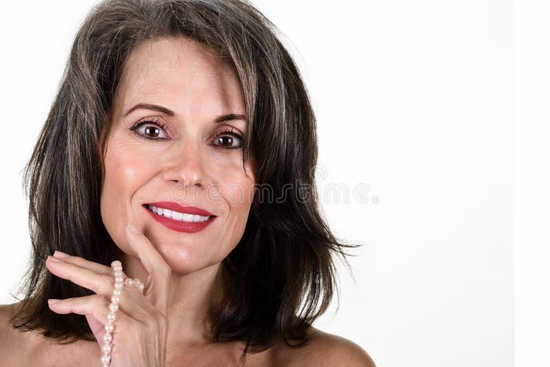Mooie rijpe vrouw stock foto