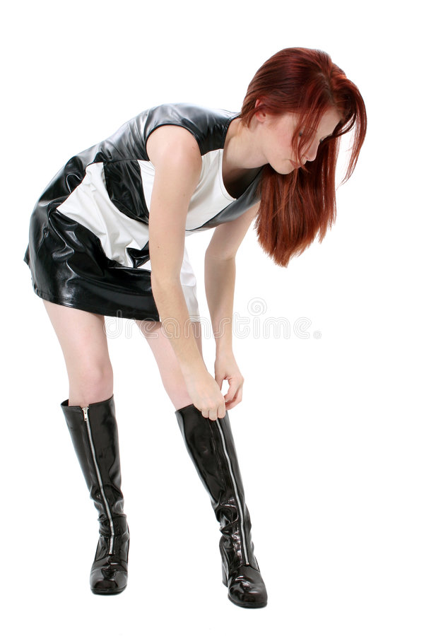 Mooie Roodharige die op Haar Laarzen snelt royalty-vrije stock fotografie