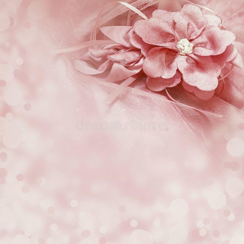 Mooie roze achtergrond met stoffenbloem royalty-vrije stock afbeelding