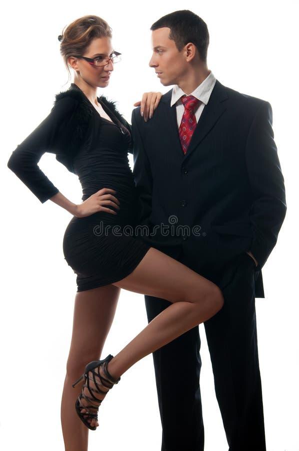 Mooie sexy dame die jonge zakenman verleiden royalty-vrije stock afbeeldingen