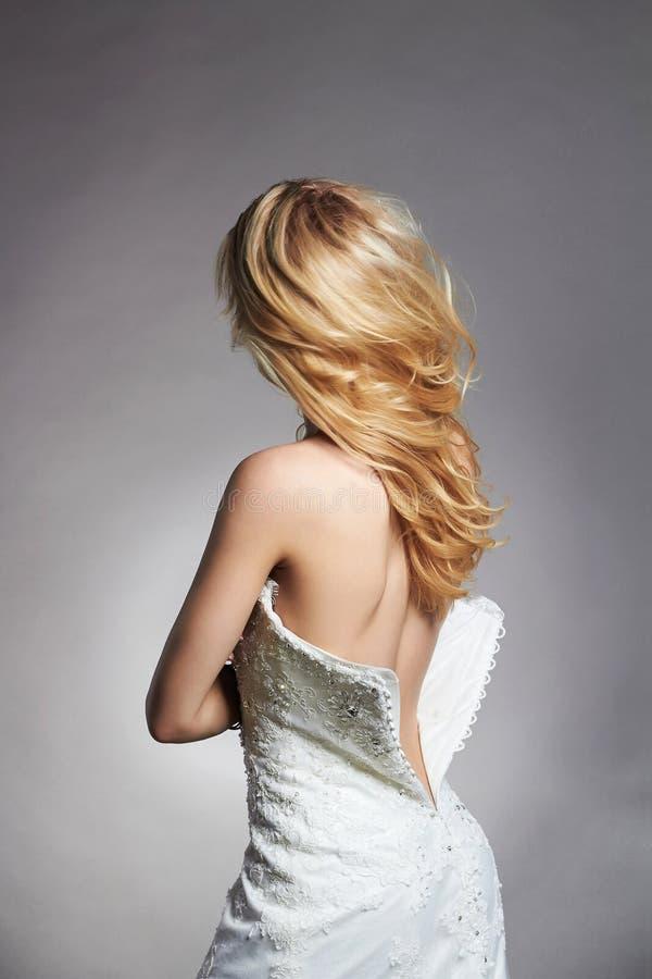 Mooie sexy rug van de vrouw van de blondebruid stock afbeeldingen