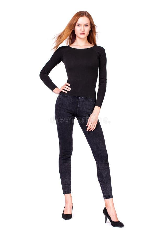 Mooie sexy vrouw in zwarte jeans stock foto's