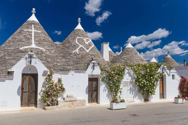 Mooie stad van Alberobello met trullihuizen, hoofd turistic district, Apulia-gebied, Zuidelijk Italië stock fotografie