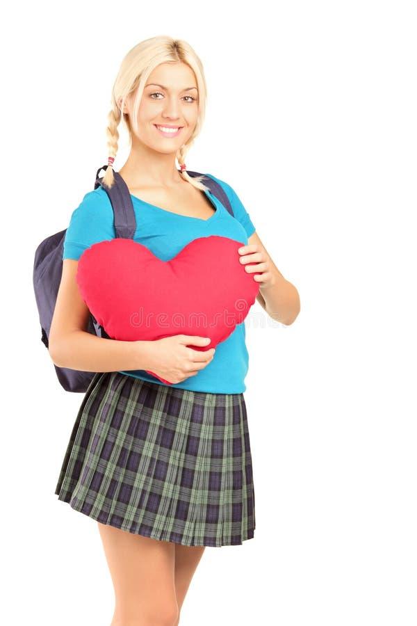 Mooie Student Die Een Voorwerp Van De Hartvorm Houdt Stock Afbeelding