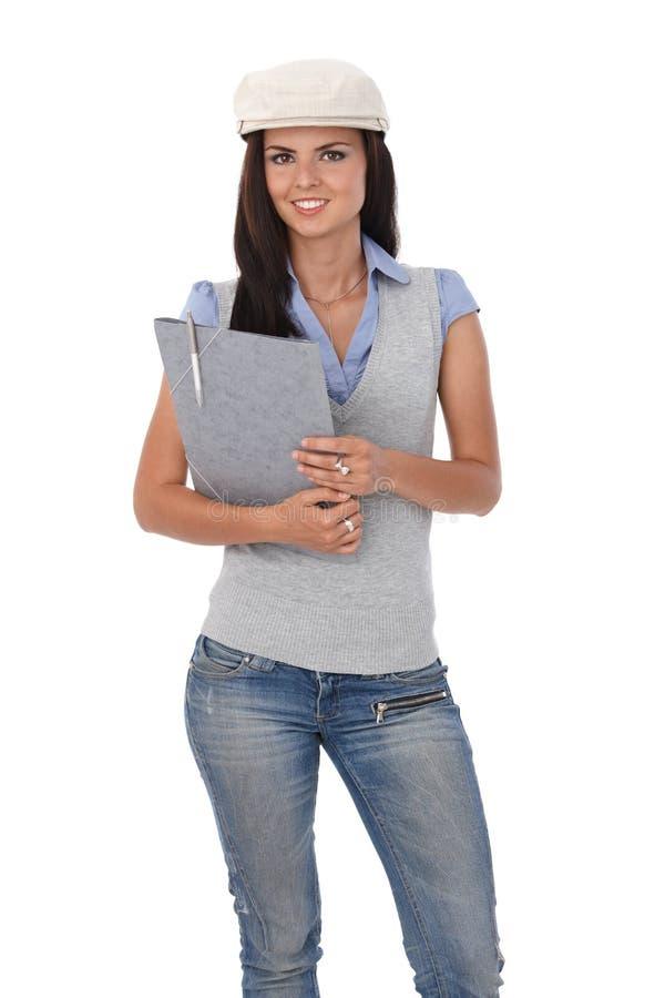 Mooie student met omslag het glimlachen stock foto