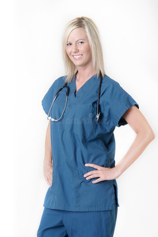 Mooie verpleegster met vriendschappelijke uitdrukking stock fotografie