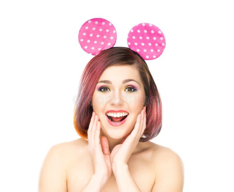 Mooie verraste vrouw in Mickey-muisoren stock afbeeldingen