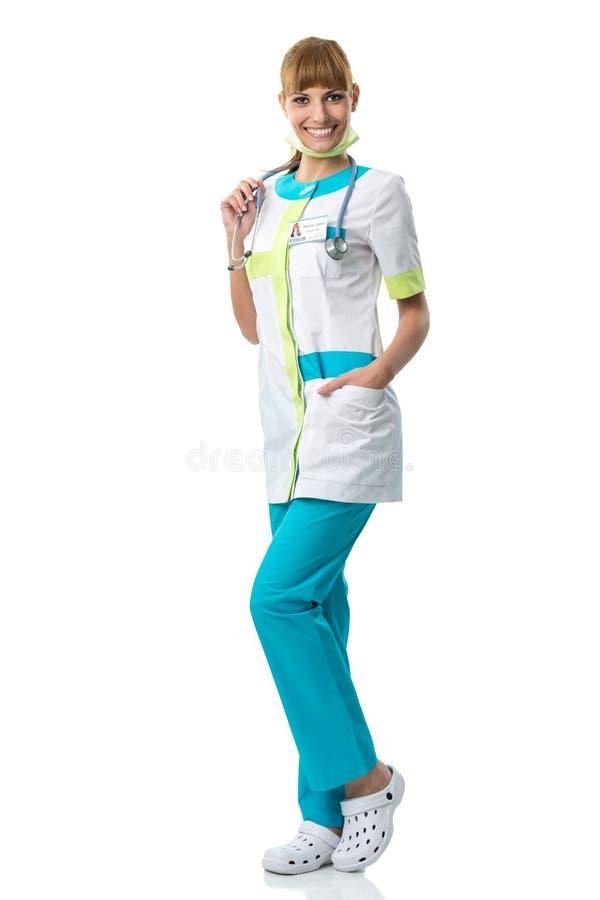 Mooie vrouw arts in haar halsstethoscoop stock afbeeldingen