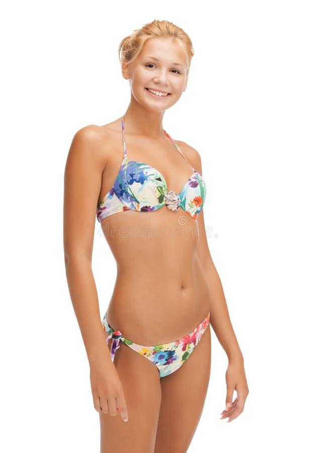 Mooie vrouw in bikini stock afbeeldingen