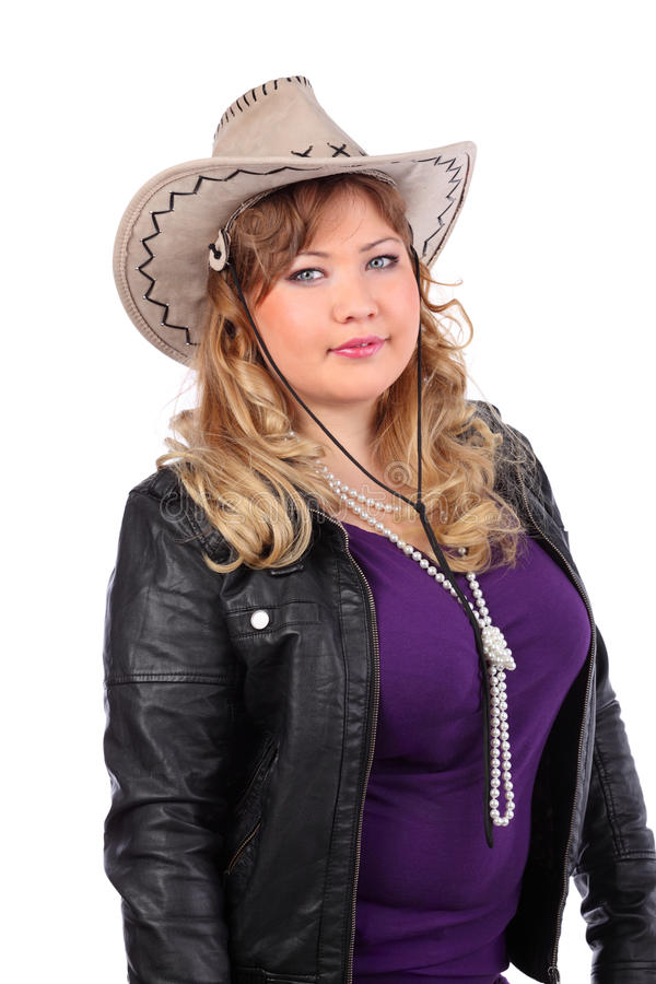 Mooie vrouw die cowboyhoed en jasje dragen royalty-vrije stock afbeelding