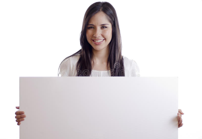 Mooie vrouw die een wit teken houden stock afbeelding