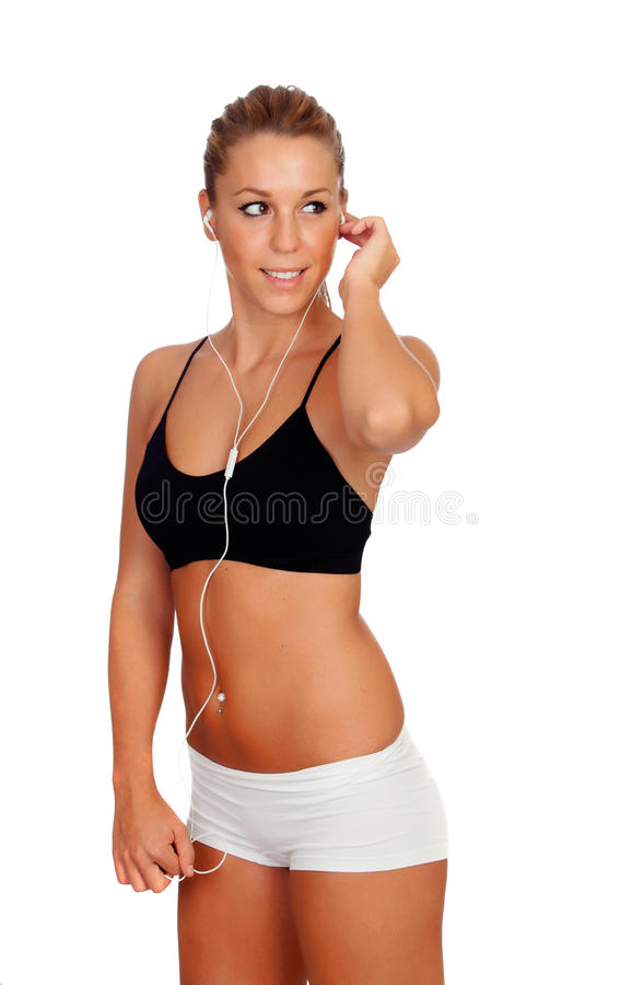 Mooie vrouw die geschiktheid het luisteren muziek met hoofdtelefoons doen stock foto