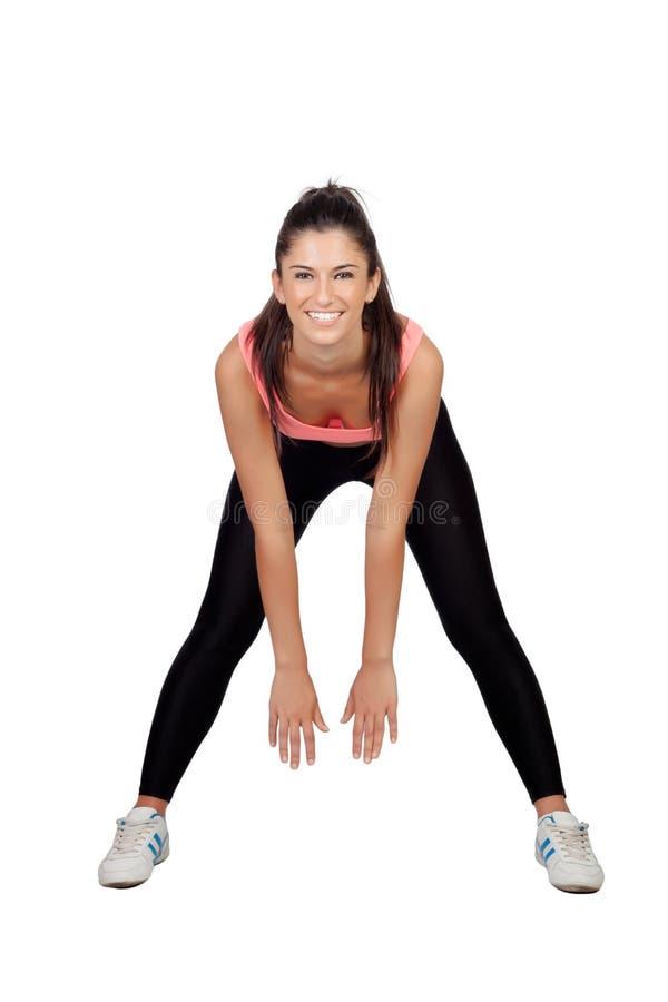 Mooie vrouw die het uitrekken doen zich in haar training stock afbeelding
