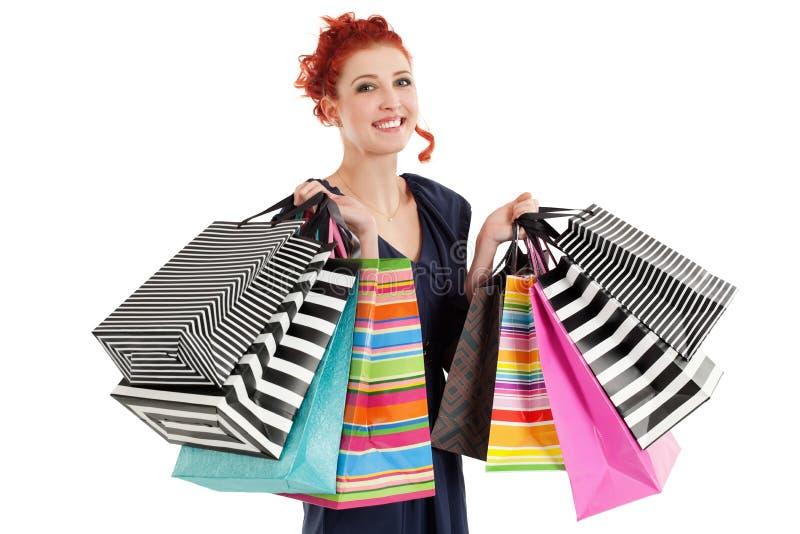 Mooie vrouw die kleurrijke zakken houdt stock fotografie