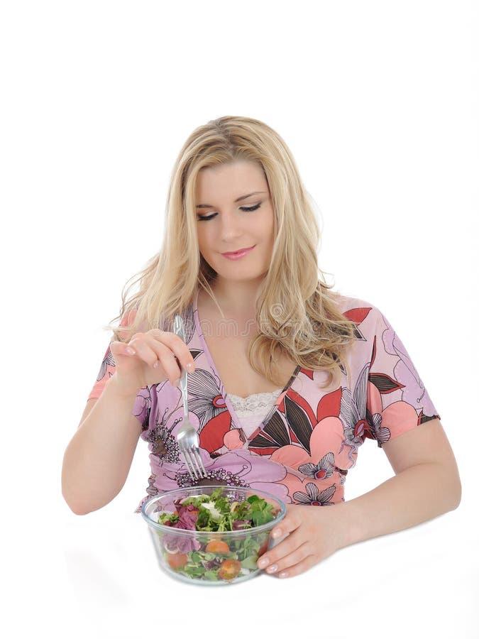 Mooie vrouw die plantaardige salade eet royalty-vrije stock fotografie