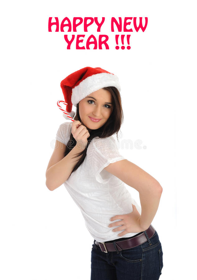 Mooie vrouw die in rode Kerstmishoed een wens maakt royalty-vrije stock afbeeldingen