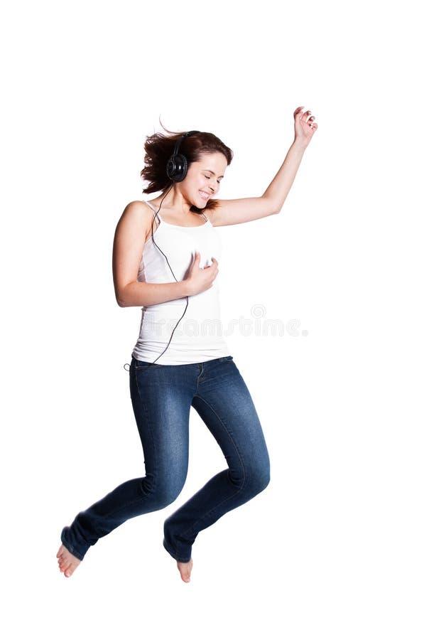 Mooie vrouw die voor vreugde springt stock foto