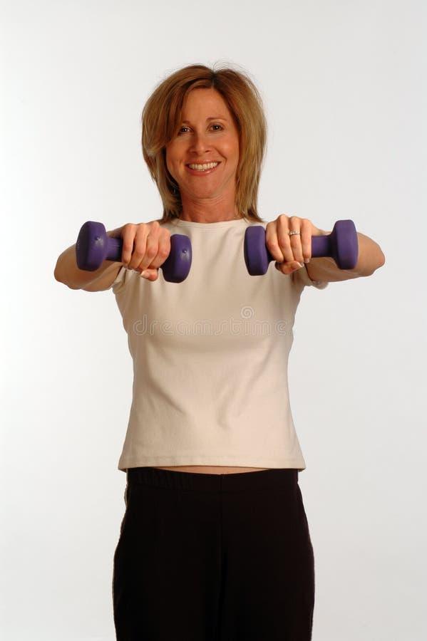 Mooie vrouw in geschiktheidsgymnastiek stock afbeeldingen