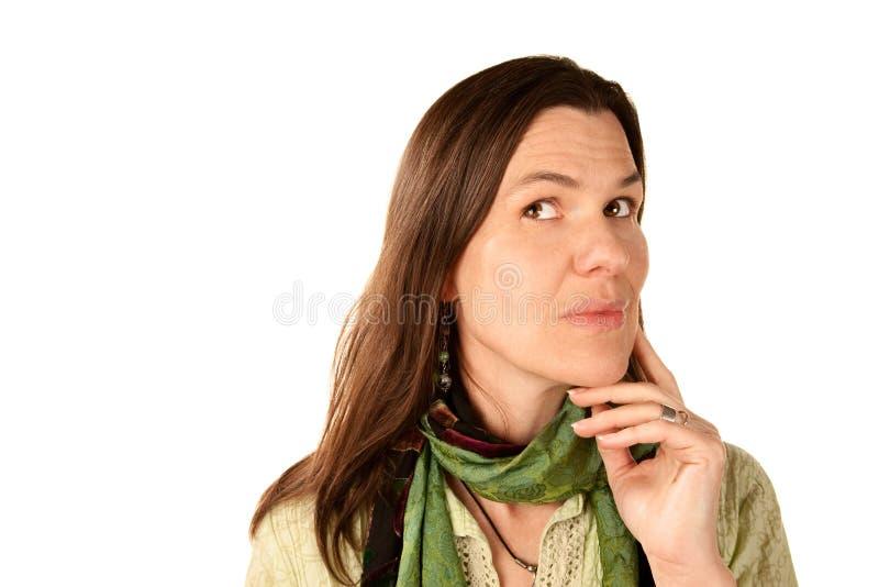 Mooie vrouw in het groene denken stock foto
