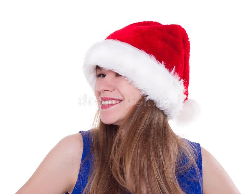 Mooie vrouw in het rode de hoed van de Kerstman lachen stock afbeelding