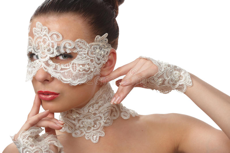 Mooie vrouw in kantmasker royalty-vrije stock fotografie