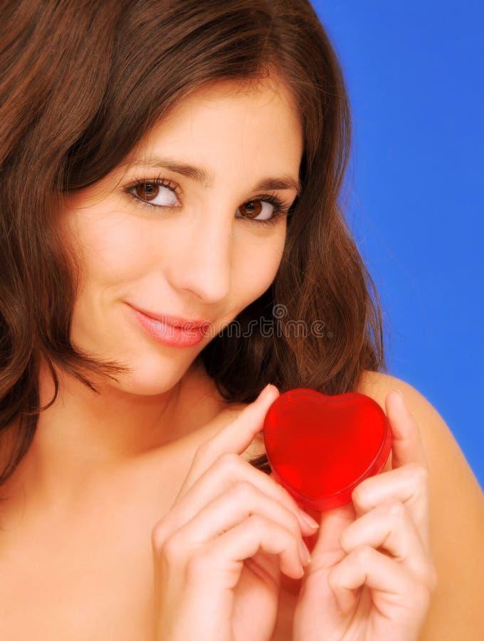 Mooie vrouw in liefde stock afbeeldingen