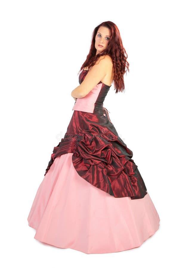 Mooie vrouw in luxueuze kleding met hoepelrok stock foto