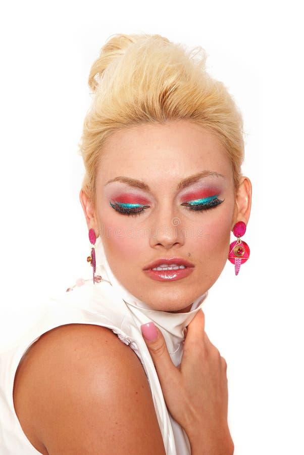 Mooie vrouw in make-up stock afbeelding