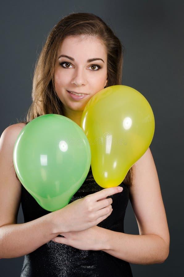 Mooie vrouw met ballons stock foto's