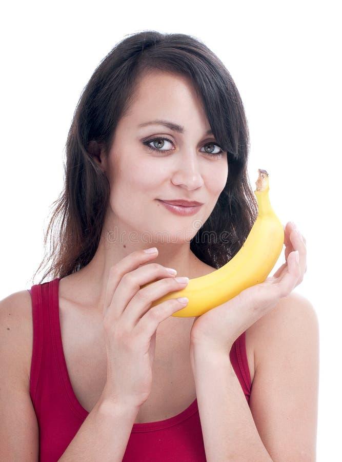 Mooie vrouw met banaan stock foto's