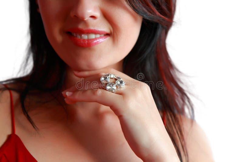 Mooie vrouw met de ring. stock fotografie