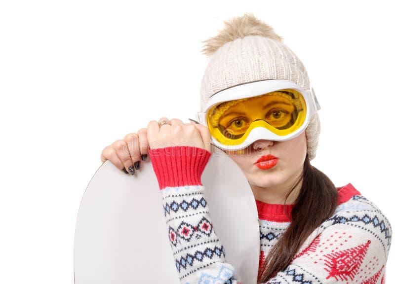 Mooie vrouw met een snowboard in studio stock foto