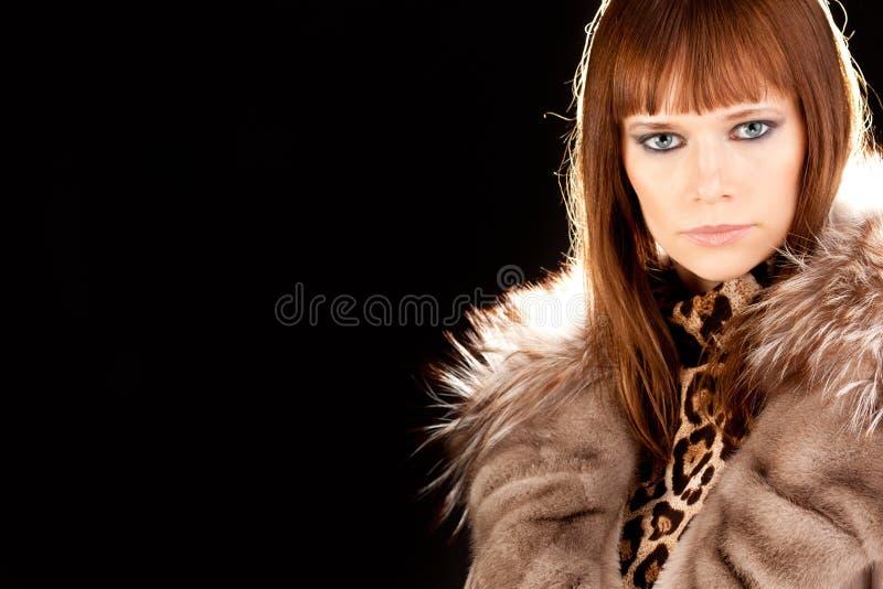 Mooie vrouw met furcoat stock foto's