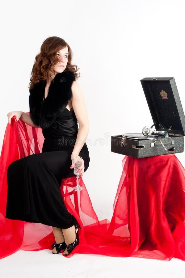Mooie vrouw met grammofoon, royalty-vrije stock foto