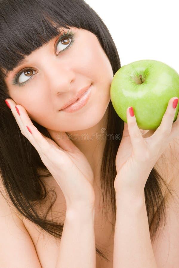 Mooie vrouw met groene appel royalty-vrije stock foto's